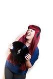 Jonge mooie vrouw die met hoofdtelefoons en vinylverslag dansen Royalty-vrije Stock Afbeelding