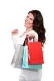 Jonge mooie vrouw die zich met spaarvarken bevindt mon Stock Fotografie