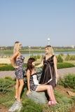 Jonge mooie vrouw drie op een de zomerdag royalty-vrije stock afbeelding
