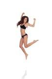Jonge mooie vrouw in het katoenen ondergoed springen Stock Foto