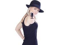 Jonge mooie vrouw met een kanon stock fotografie