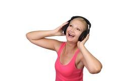 Jonge mooie vrouw met hoofdtelefoons Royalty-vrije Stock Afbeeldingen