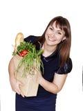 Jonge mooie vrouw met zak van producten in handen Stock Afbeelding
