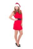 Jonge mooie vrouw in rode die kleding en santahoed op whi wordt geïsoleerd Royalty-vrije Stock Afbeelding