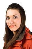 Jonge mooie vrouw in rood jasje Stock Afbeeldingen