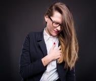 Jonge onderneemster die hartkwaal hebben Stock Afbeeldingen