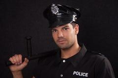 Jonge politieagent met blackjack stock fotografie