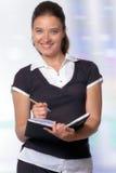 Jonge Professionele Vrouw die Nota's neemt Royalty-vrije Stock Afbeeldingen