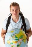 Jonge reiziger met bol Stock Afbeeldingen