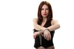 Jonge saxy brunette in handcuffs royalty-vrije stock foto