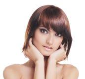 Jonge sexy brunette die over wit wordt geïsoleerdt Royalty-vrije Stock Afbeelding
