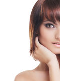 Jonge sexy brunette die over witte achtergrond wordt geïsoleerd Royalty-vrije Stock Foto's