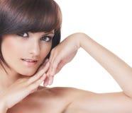 Jonge sexy brunette die over witte achtergrond wordt geïsoleerd1 Royalty-vrije Stock Fotografie