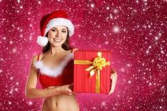 Jonge sexy Kerstman over de achtergrond van Kerstmis Royalty-vrije Stock Afbeelding