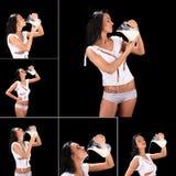 Jonge sexy mooie die vrouw met melk, op zwarte wordt geïsoleerd Stock Fotografie