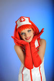 Jonge sexy verpleegster met rood haar Royalty-vrije Stock Foto's