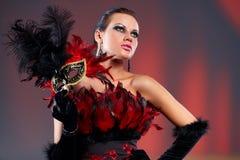 Jonge sexy vrouw in zwart partij half masker Royalty-vrije Stock Foto