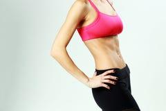 Jonge sportvrouw met perfect fitness lichaam Royalty-vrije Stock Fotografie