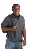 Jonge student die met zak glimlacht. royalty-vrije stock afbeeldingen