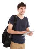 Jonge student die tabletPC met behulp van Stock Afbeelding