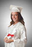 Jonge student met diploma op wit Stock Foto's
