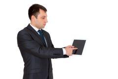 Jonge succesvolle die zakenman in een pak, op wit wordt geïsoleerd Stock Afbeelding