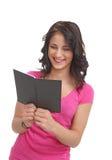 Jonge tiener met boek het lachen Stock Foto