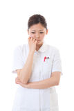Jonge verontruste verpleegster Stock Foto