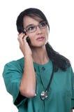 Jonge verpleegster met cellulair royalty-vrije stock foto