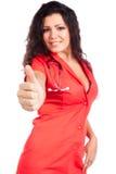 Jonge verpleegster of vrouwenarts met omhoog duim Royalty-vrije Stock Afbeeldingen