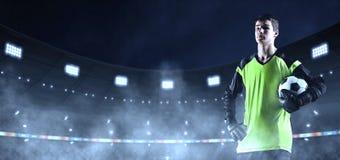 Jonge voetbalkeeper in ongemerkte doek op het 3D voetbal stad stock afbeeldingen