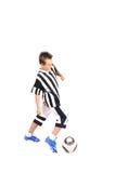 Jonge voetballer met bal Stock Foto's