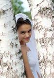 Jonge vrouw in bruids kostuum stock foto's