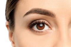 Jonge vrouw, close-up van oog stock afbeelding