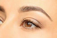 Jonge vrouw, close-up van oog stock fotografie