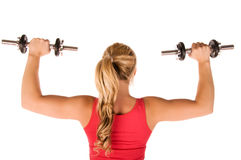 Jonge vrouw in de gymnastiek Royalty-vrije Stock Afbeelding