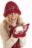 Jonge vrouw in de sneeuw Stock Afbeelding