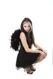 Jonge vrouw in de zwarte kleding stock foto