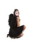 Jonge vrouw in de zwarte kleding stock afbeelding