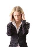 Jonge vrouw die aan een hoofdpijn lijdt Stock Afbeeldingen