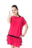 Jonge vrouw die duim tonen Stock Afbeeldingen