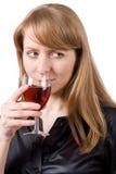 Jonge vrouw die een glas wijn proeft. #1 Stock Foto's