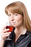 Jonge vrouw die een glas wijn proeft. #2 Stock Afbeeldingen