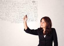 Jonge vrouw die en het berekenen gedachten schetsen royalty-vrije stock afbeeldingen