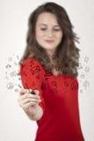 Jonge vrouw die en pictogrammen en symbolen trekken schetsen Royalty-vrije Stock Afbeelding