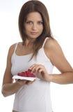 Jonge vrouw die framboos eet Stock Foto's