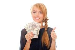Jonge vrouw die in hand dollars van het contant geldgeld houdt Royalty-vrije Stock Afbeeldingen