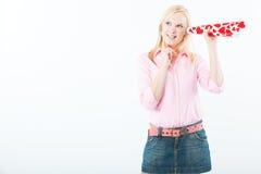 Jonge vrouw die met liefdetrompet luistert Stock Fotografie