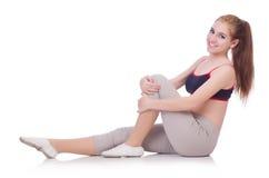 Jonge vrouw die oefeningen doen Stock Afbeelding