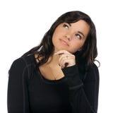 Jonge vrouw die omhoog in overpeinzing kijkt royalty-vrije stock foto